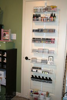 This is an Elfa pantry/spice door/wall rack.  It holds paint daubers, lesser-used ink pads & reinkers, colored ink mists, embroidery thread, punches and some alterable containers.