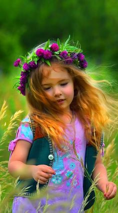 DC:  This was me when I was little - not really - but could have been - long red hair,  running through a hay field before it was cut, raked, and baled.