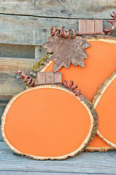Painted Wood Slice Pumpkins: Real pumpkins may be your go-to, but these pretty, painted pieces will last year after year.Brighten your porch or outdoor area with this easy and rustic DIY pumpkin slice. Find more simple, inexpensive and fun Fall decor ideas and inspiration here.