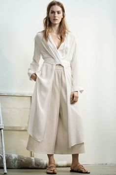 Long white V-neck shirt with draped front, wrap-around ties, and high side slits. | H&M Trend