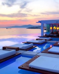 Cavo Tagoo Mykonos in Mikonos, Greece. High-end hotel offering upscale quarters, sophisticated dining & a chic spa, plus an infinity pool. Vacation Places, Vacation Destinations, Dream Vacations, Vacation Spots, Cavo Tagoo Mykonos, Paradise Travel, Beautiful Places To Travel, Greece Travel, Travel Europe