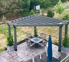Project Plans: Corner Pergola Free Standing & Attached Love the view of this family's corner pergola over their fire pit! Notice how the color of the glass rocks tie in with their umbrella! Pergola D'angle, Corner Pergola, Wooden Pergola, Gazebo, Pergola Lighting, Metal Pergola, Metal Roof, Corner Patio Ideas, Fire Pit Pergola