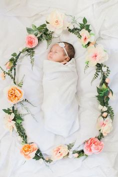 Custom Floral Wreath! Perfect for your newborn photography, or can be used as a beautiful accent for a baby shower, birthday party or wedding.  This listing comes with your choice of one color (not including greenery). This letter is made with high quality artificial flowers. Variations in flowers and colors will occur due to availability of flowers at the time you place your order. Approval images will be sent to you during the order process.  Please contact me with any custom orders.