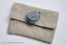 Love the flower with the rough texture fabric, clutch handbag and other ideas