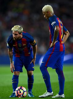 Lionel Messi (L) and Neymar Jr. of FC Barcelona look on during the La Liga match between FC Barcelona and Deportivo Alaves at Camp Nou stadium on September 10, 2016 in Barcelona, Catalonia.