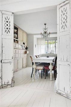 Love these white shutters repurposed as  doors!!