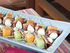 Melon, Mozzarella, and Prosciutto Skewers | Super easy finger foods are the perfect way to kick off a party. No forks or spoons are required for these easy-to-pick-up party foods, so you can clean up in no time. If you decide to throw an all-appetizer party, make sure you provide a variety of options: chips and dip, warm spreads, easy pick ups, and even one-bite salads can be combined to set out the perfect spread. You'll like these easy finger foods so much that you might even skip dessert.