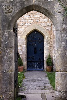Antique blue door on one of the Almshouses in Wells, Somerset, UK