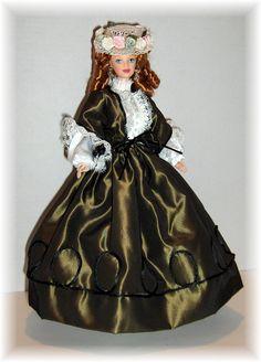 Circa 1850's, early Victorian period. Costume created by Marcene Burtt.