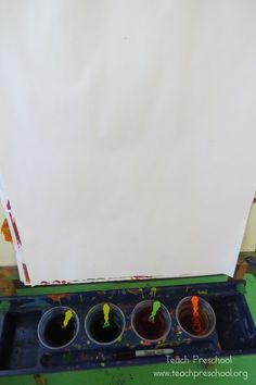 Bubble painting at the easel -blow bubbles with watered-down paint onto the paper