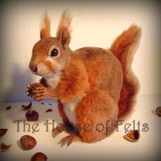 THIS IS A FINISHED PIECE AND IS READY TO BE POSTED TO ITS NEW HOME up for sale is a OOAK needle felted red squirrel made by myself and true to