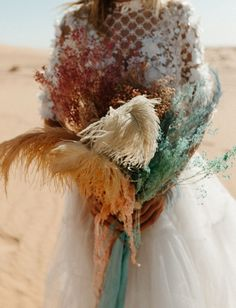This colorful Moroccan elopement inspiration features a unique wedding dress with a mint skirt, painted ostrich feathers, and textured florals. Fall Bouquets, Wedding Bouquets, Wedding Flowers, Dried Flower Bouquet, Dried Flowers, Ostrich Feathers, Elopement Inspiration, Alternative Wedding, Wedding Trends