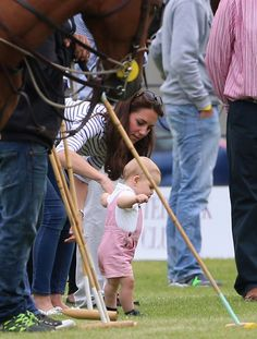 Kate Middleton: Catherine, Duchess of Cambridge and Prince George of Cambridge attend the Royal Charity Polo during the Maserati Jerudong Trophy at Cirencester Park Polo Club on June 15, 2014 in Cirencester, England.
