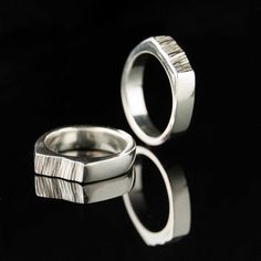 Really cool idea!! https://www.etsy.com/listing/81634448/matching-saw-cut-wedding-rings-set-of-2