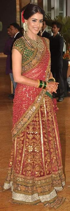 Genelia D'souza in a red half saree with green blouse having zardosi and sequin work by Sabyasachi Mukherjee / Lehnga Saree Indian Bridal Wear, Indian Wear, Indian Dresses, Indian Outfits, Indian Fashion Designers, Desi Clothes, Indian Couture, Indian Attire, Indian Celebrities