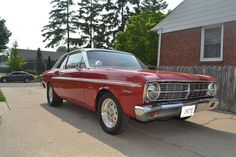 This 1967 Ford Falcon is a classic American car. Although the Falcon didn't look as agressive as its successor (the Mustang), it still packed a punch that was impressive. Just check out this engine! http://i.imgur.com/tMDF3.jpg