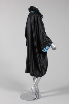 Liberty & Co black and blue satin evening coat, 1920s, with padded, ruched collar, fagotted sleeve seams, lined in blue satin, of voluminous kimono cut