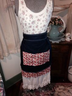 A personal favorite from my Etsy shop https://www.etsy.com/listing/227341309/womens-navy-blue-and-orange-floral-apron
