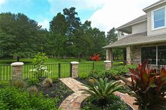 wrought iron fence with stone pillars - Google Search