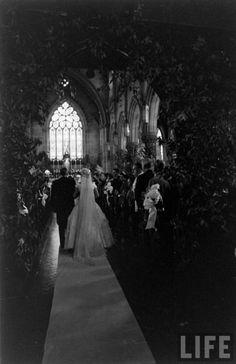 Rare photo of Jackie Onassis walking down the isle at her wedding to JFK.