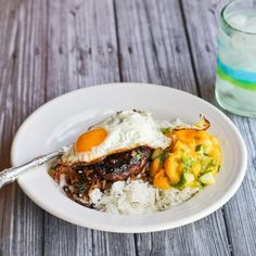 Loco Moco, a Hawaiian specialty of a hamburger on rice with Pacific Rim flavored gravy, served with Mango Cucumber Relish