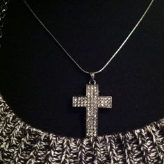 Gunmetal Crystal Cross Pendant Gunmetal (dark gray) snake chain with lobster catch and gunmetal crystal cross (1  3/4 in.) give that edgy look to your sparkle!  This new necklace is a great addition to any cross collection! Just bundle 2 items or more for automatic 15% discount! A Bead and a Pearl... Jewelry Necklaces