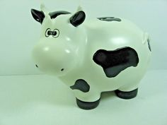 """Collectible Ceramic Cow Bank - White with black spots - 5 1/2"""" Tall x 6 1/2 Long"""