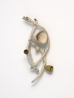 Brooch | Heejoo Kim.  Enameled copper and painted paper.