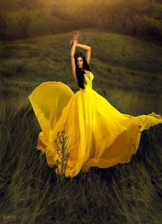 This beautiful young woman looks like she feels great in her gown flowing in the breeze!