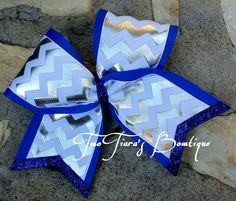 Shiny cheer bow! I have made these with the base and trim in many different colors for teams and individuals.  By Two Tiara's Bowtique on Etsy or Facebook as TwoTiaras Bowtique for more options.
