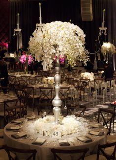 Empty vase, spotlight, white florals, white flowers, white roses, centerpieces, floral arrangements, wedding florals, table settings, wedding reception, dim lighting, wedding photography