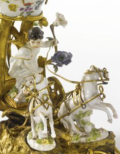 A LOUIS XV ORMOLU AND MEISSEN PORCELAIN CHARIOT GROUP MID-18TH CENTURY