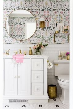 – at home with Ashley Bathroom Reveal! Check out this beautiful DIY bathroom with pink floral wallpaper, brass accents, a round mirror, marble vanity, subway tiles. It's a girly decor dream! For a small bathroom it sure is big on style! Diy Bathroom, Bathroom Interior, Girl Bathrooms, Girl Bathroom Ideas, Bathroom Colors, Modern Bathroom, Master Bathroom, Bathroom Small, Minimalist Bathroom
