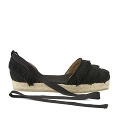 'Phoebe' flat espadrilles from Spanish label Castañer. Constructed from natural cotton canvas uppers, the sandals feature a closed toe design and heel counter with tonal fringe detailing. A self-tie ankle strap ensures a secure fit. Set on a classic jute rope midsole with a thin vulcanised rubber outsole. Upper: Cotton. Sole: Rubber. Made in Spain