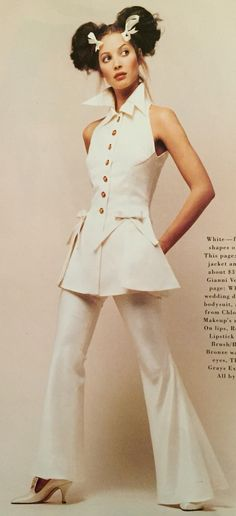 Gianni Versace- S/S 1993 White tunic vest over bell bottom pants with bow details. Harper's Bazaar January 1993