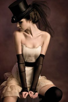 I love the tulle wrapped around the hat and flowing down behind