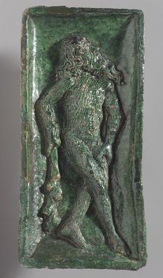 German Wild Man stove tile, ca. 1480. Earthenware with lead glaze.