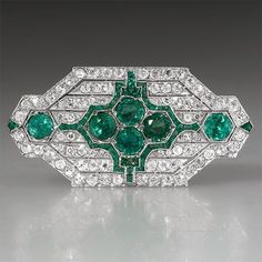 Art Deco Antique Emerald & Diamond #brooch Pin Solid Platinum. This amazing Art Deco antique brooch pin is crafted of solid platinum and features natural emeralds and diamonds and is in very good condition. #DiamondBrooches