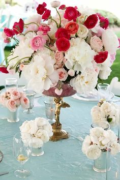 like color combo - start with base of white garden roses and and add colorful pink/fuschia ranunculus.