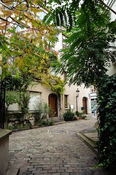 13th arrondissement - the cobblestoned Square des Peupliers is lined with small houses, each with its own little garden. With its trees and climbing roses, it is especially beautiful in the springtime.