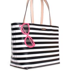 """Kate Spade Splash Out Stripe Sunglasses Tote Authentic Kate Spade SPLASH OUT STRIPE SUNGLASSES FRANCIS TOTE  Perfect for your winter getaway or Spring Break.   Apair of cute hot pink sunglasses decorate this striped popular francis, a roomy canvas tote with leather handles.  SIZE?10.9""""h x 12.9""""w x 6.4""""d,?drop length: 9"""" Zip top closure  Very good, Preowned condition. Only carried on my vacation to Hawaii for 2 weeks.  The corners show a little rubbing, a few light marks on bag, ks plate has…"""