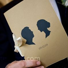 a silhouette artist create designs that they incorporated into their handmade ceremony programs and other wedding details.