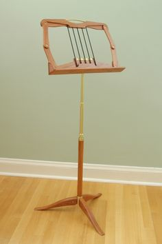 Most beautiful music stand Woodworking For Mere Mortals, Woodworking Plans, Wooden Guitar Stand, Wooden Musical Instruments, Book Rest, How To Bend Wood, Music Stand, Steel Art, Music Decor