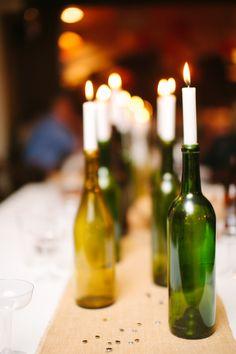 wine bottles holding candles http://www.weddingchicks.com/2013/10/25/navy-and-orange-wedding/