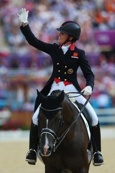 REPIN it if you love it! Charlotte Dujardin looking thrilled after taking gold in the individual dressage freestyle today! (Love the helmet!) Great Britain took home the gold and bronze today with the Netherlands winning the silver. (Photo credits: Sky Sports)