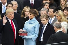 Dennis = Melania ? Donald Trump is sworn in as the 45th president of the United States by Chief Justice John Roberts as Melania Trump looks on during the 58th Presidential Inauguration at the U.S. Capitol in Washington, Friday, Jan. 20, 2017
