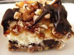 turtle cheesecake bars- crust 3 cups finely chopped pecans 1 stick unsalted butter, melted 1/3 cup sugar 1/4 teaspoon salt cheesecake filling 24 oz cream cheese, softened 1/4 cup full-fat greek yogurt or sour cream 3/4 cup sugar 1 tablespoon vanilla 3 large eggs 1 cup semi-sweet chocolate chips toppings 1 cup coarsely chopped pecans, toasted 1 11-oz bag caramel candy, unwrapped 1 cup semi-sweet chocolate chips 6 tablespoons milk, divided
