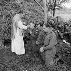 Father C V Murphy carries out Mass in a Dutch field in the front line, 6 October 1944 British Army  Remembrance Day or Poppy Day is also on Nov 11