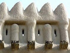 Window in a wall in Djenne, Mali.           Ndalama African Desert Crafts