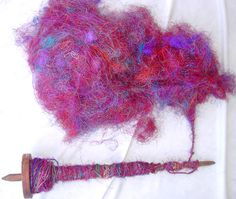 How to make recycled silk sari yarn.  Made from fringe reminents and silk thread scraps that can be purchased from small mills in India